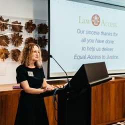 The Hon. Justice Smith of the Supreme Court of Western Australia standing at a lecturn giving a speech to launch the Law Access Impact Report
